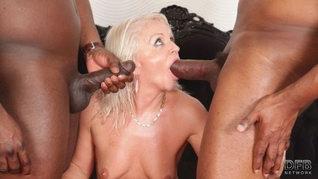 Two black guys fuck a mature blonde